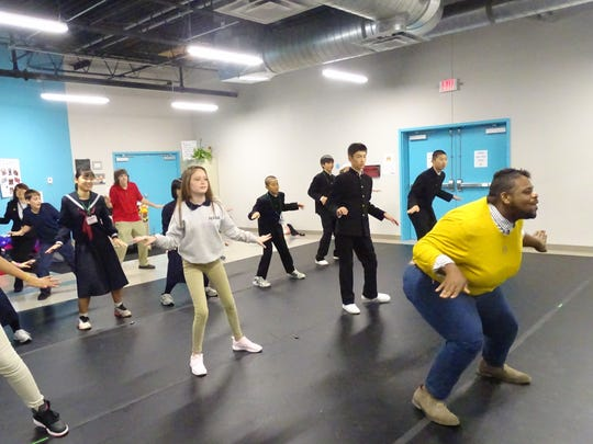 Students from Fukushima, Japan have a dance lesson with dance instructor Deon Taylor and students from Richland School of Academic Arts.