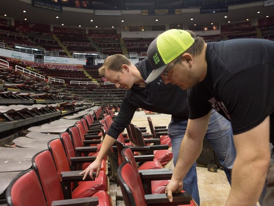 Brian Kean, left, picks out stadium seats he purchased with the help of Ryan Johnson of Greenville at Joe Louis Arena on May 14, 2018.