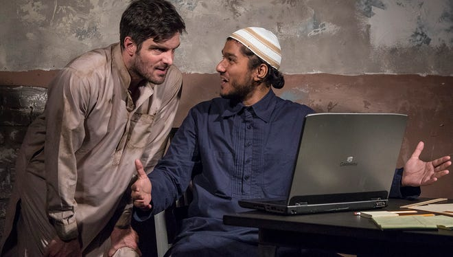 """John Tufts, left, and Jameal Ali star in the Ensemble Theatre Company's production of  """"The Invisible Hand,"""" on stage through April 29 at The New Vic Theatre in Santa Barbara."""