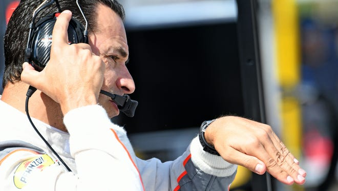 Helio Castroneves debriefs after testing for Team Penske on Monday at the Mid-Ohio Sports Car Course in Lexington.