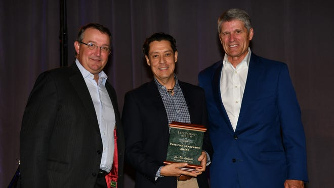 Pictured from left, LifePoint president and COO David Dill, Dr. John Andazola and LifePoint Chairman and CEO Bill Carpenter.