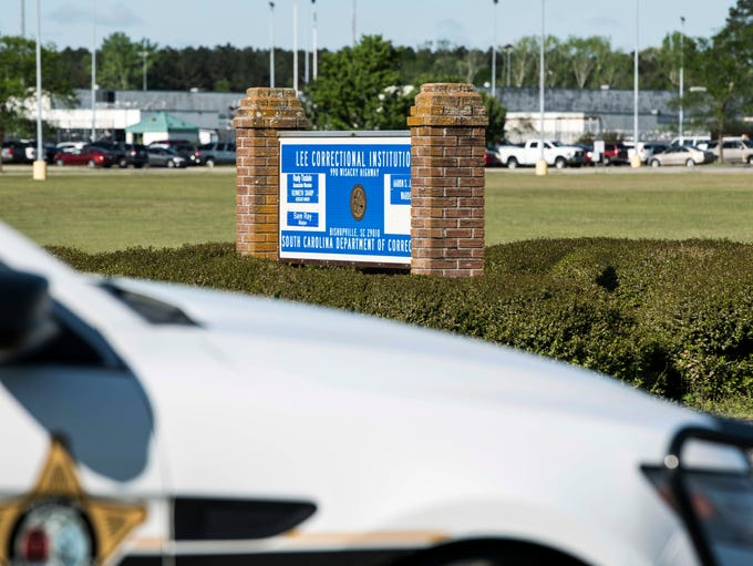 A police vehicle sits outside the Lee Correctional