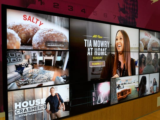 A collage of shows plays in the lobby of the Scripps Networks Interactive corporate headquarters in Knoxville in February 2017.