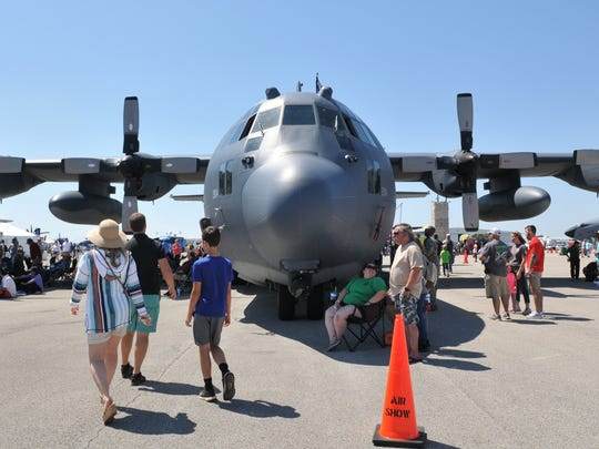 Spectators stroll past static displays during the 2018 Melbourne Air & Space Show at Orlando Melbourne International Airport.