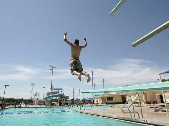 A Surprise teen jumps off the diving board at the Surprise Aquatic Center in 2009. Expansion of the facility was one project proposed with the city's bond request.