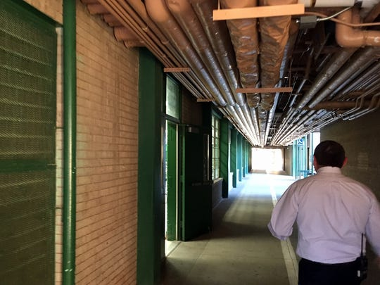 Ross Middle School Principal Jason Yturralde walks down the hallway to the school cafeteria during a tour for the El Paso Independent School District Facilities Advisory Committee.