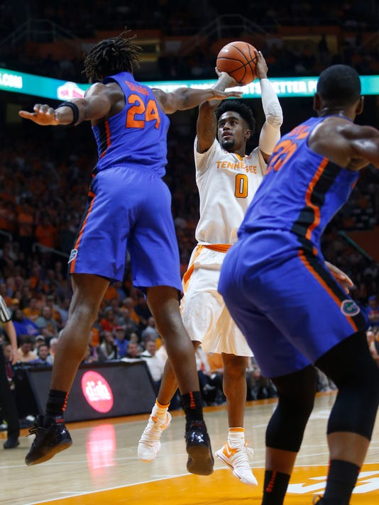Tennessee guard Jordan Bone (0) goes up for a basket in front of Florida guard Deaundrae Ballard (24) in the first half of an NCAA college basketball game Wednesday, Feb. 21, 2018, in Knoxville, Tenn. (AP Photo/Crystal LoGiudice)
