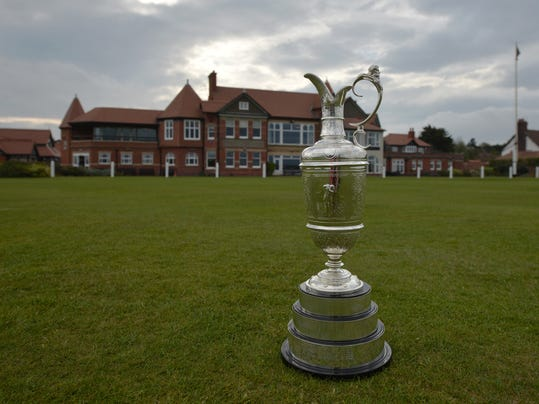 "The British Open Golf trophy the ""Claret Jug"" is displayed  by the clubhouse at the Royal Liverpool Golf Club before the British Open golf championships, Hoylake, England, Wednesday, April 22, 2014.  The tournament begins on Thursday July 17, 2014. (AP Photo/Jon Super)"