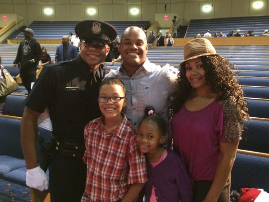 James Hill-Harris celebrates the graduation last August of his brother Sequoia Turner, left, from   the Detroit Police Academy, along with Hill-Harris' wife India and children Mariyon and SaVanna.