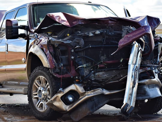 A red Ford truck was heavily damaged following a wreck on June 25, 2018 on Sherwood Way.