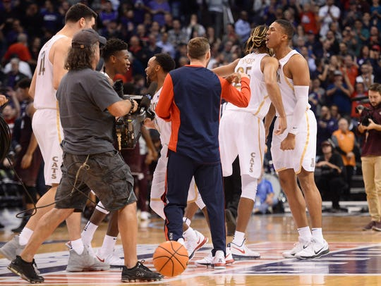 Arizona Wildcats players celebrate after defeating