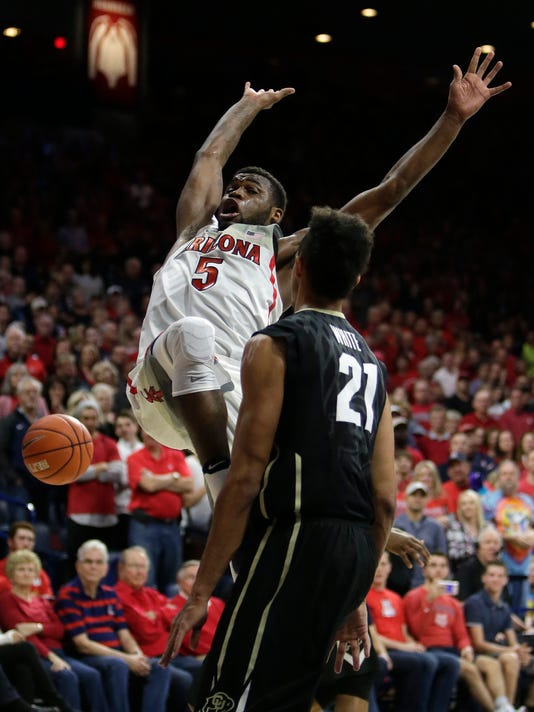 Arizona guard Kadeem Allen (5) loses the ball in front of Colorado guard Derrick White during the second half of an NCAA college basketball game, Saturday, Jan. 7, 2017, in Tucson, Ariz. Arizona defeated Colorado 82-73. (AP Photo/Rick Scuteri)
