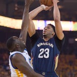 April 20, 2015; Oakland, CA, USA; New Orleans Pelicans forward Anthony Davis (23, right) shoots the basketball against Golden State Warriors forward Draymond Green (23, left) during the first quarter in game two of the first round of the NBA Playoffs at Oracle Arena. Mandatory Credit: Kyle Terada-USA TODAY Sports