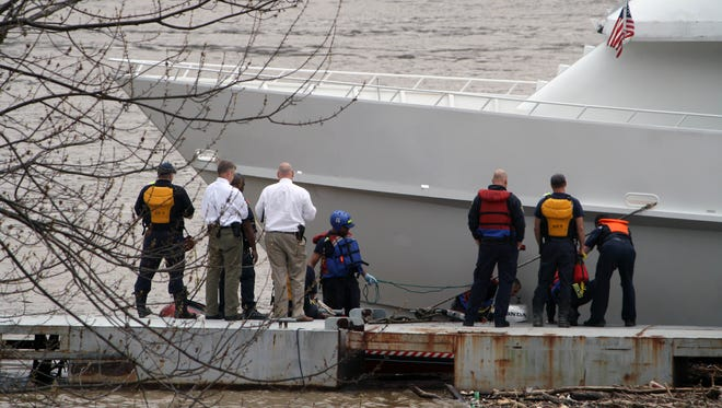Crews investigate after a body was found in the Ohio River April 8 at the Riverview Landing Marina.
