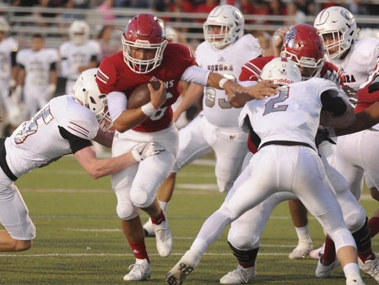 Jim Ned running back Cooper Castro tries to fight through