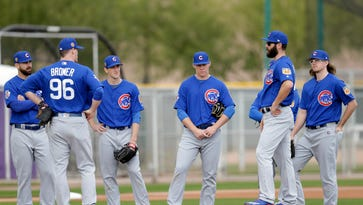 Chicago Cubs starting pitcher Jake Arrieta (49) holds a meeting on the field during spring training camp at Sloan Park.