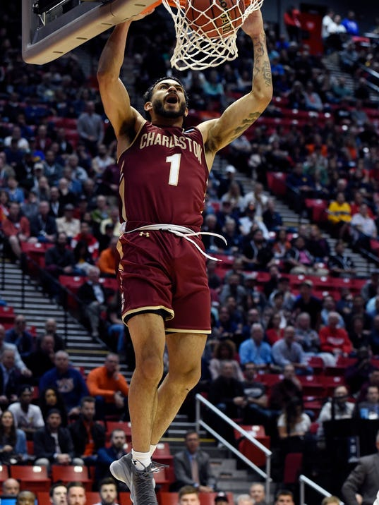Charleston guard Grant Riller (1) dunks during the first half of a first-round NCAA college basketball tournament game against Auburn, Friday, March 16, 2018, in San Diego. (AP Photo/Denis Poroy)