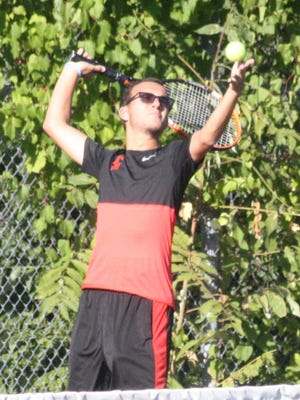 Churchill's No. 4 singles player Peyton Elkins delivers a serve during Monday's match against Farmington.
