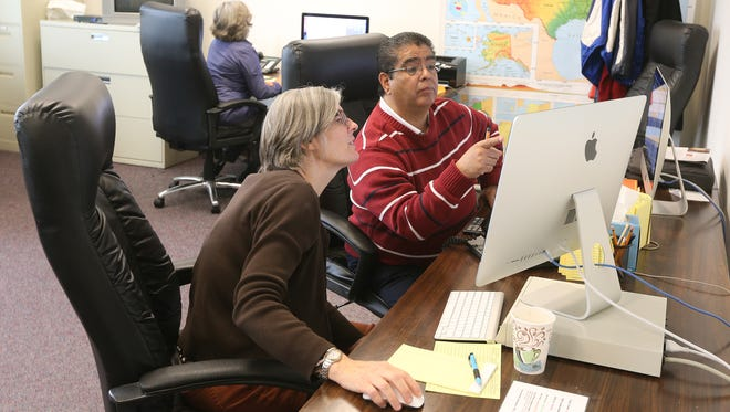 Teachers Beth Hall and Noel Ruiz working are with the Dial-a-Teacher program operated by the Rochester Teachers Association.
