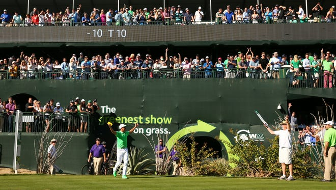 Rickie Fowler pumps up the gallery at the 16th hole during round three at TPC Scottsdale on Feb. 4, 2017 at Waste Management Phoenix Open in Scottsdale, Ariz.