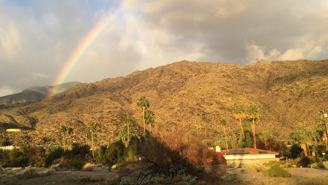 A rainbow is visible above Palm Springs after a small amount of rain fell on the area early Thursday. Weather experts say more rain could fall throughout the day.