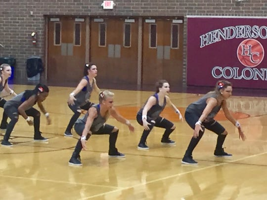 The HCHS Colonelettes get in formation during a dress
