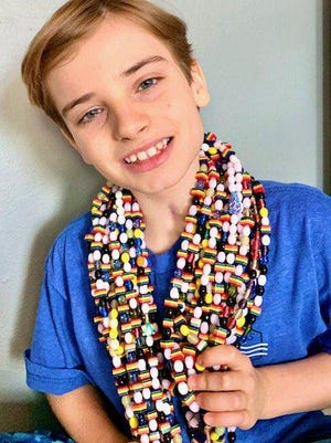 Parker Gerault was diagnosed with a brain stem tumor when he was 6, and what followed was a long series of operations and chemotherapy. During his time in the hospital, Gerault received beads of courage every time he faced a new medical procedure. Gerault, who is now 9, and his family are excited to attend the Trail of Hope on Oct. 24 at Westlake High School to honor cancer survivors and patients. [Contributed photo[