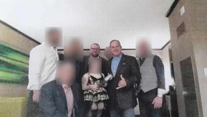 Scott Maddox and J.T. Burnette are pictured with at least three undercover FBI agents. After internal discussions and conversation with the FBI, the Democrat decided to blur the faces of the undercover agents and three unidentified individuals.