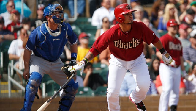Feb. 26, 2014 - Gerardo Parra drops his bat after hitting a triple against the Dodgers during a spring training game at Salt River Fields.