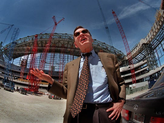 Bud Selig stands in front of the construction of Miller Park in Milwaukee.