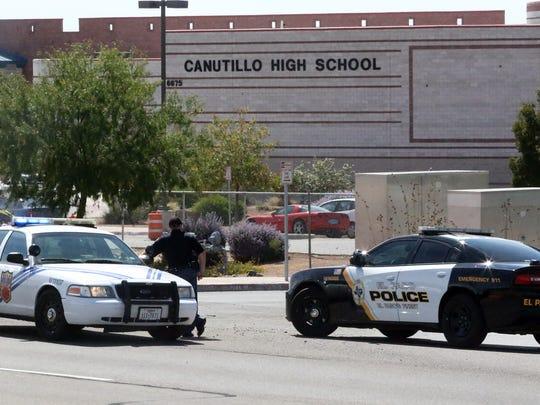 El Paso police are seen along South Desert Boulevard