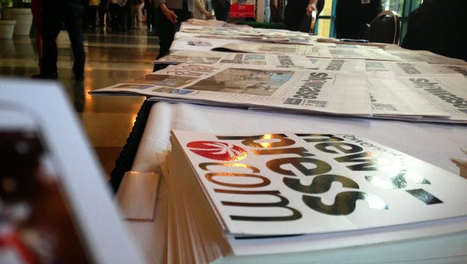 People mill around the News-Press table at MarketWatch 2015 event at Harborside in February.