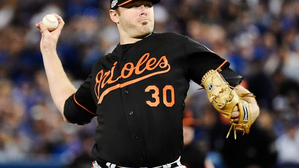 Baltimore Orioles starting pitcher Chris Tillman pitches against the Toronto Blue Jays during the first inning of an American League wild-card baseball game in Toronto, Tuesday, Oct. 4, 2016. (Nathan Denette/The Canadian Press via AP)