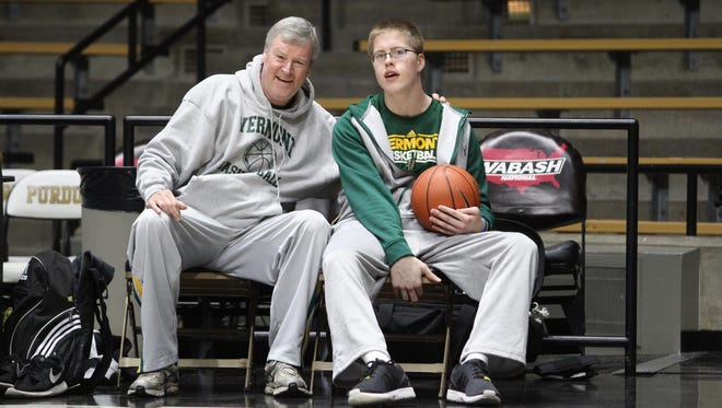 Former University of Vermont men's basketball coach Tom Brennan, left, and Josh Speidel chat with each other before the Catamounts' game at Purdue in 2015.