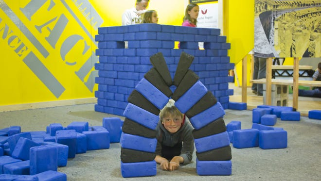 Visitors have fun while learning in the Build Zone exhibit at Impression 5 Science Center.