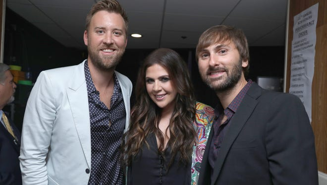 Lady Antebellum's Charles  Kelley, Hillary Scott, and Dave Haywood have grown their sound and families in the last year.