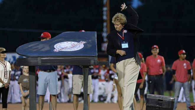 Connie Mack World Series Chairwoman Carol May gives a special final farewell performance on the pitcher's mound as a CMWS committee member during the opening ceremony Thursday at Ricketts Park.