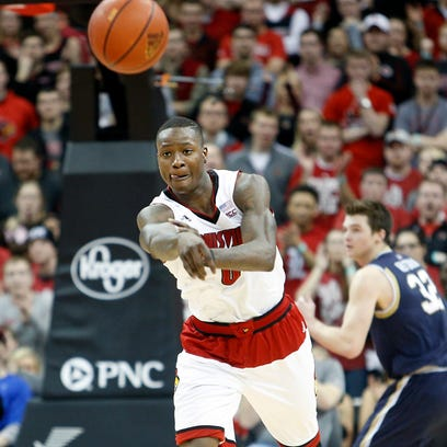 Louisville's Terry Rozier passes the ball down court.