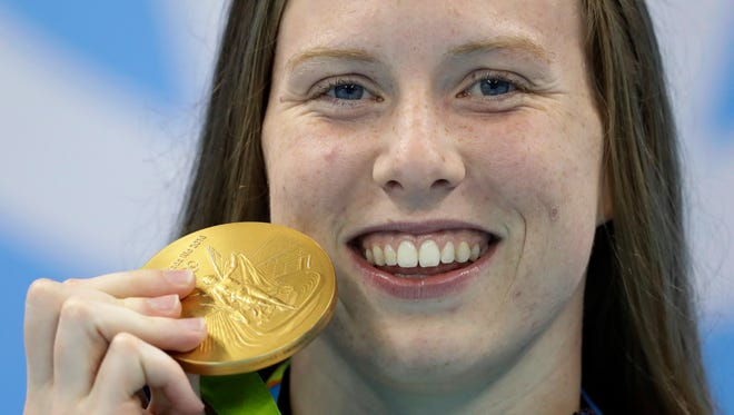 United States' Lilly King shows off her gold medal during the ceremony for the women's 100-meter breaststroke final during the swimming competitions at the 2016 Summer Olympics, Aug. 9, 2016, in Rio de Janeiro.