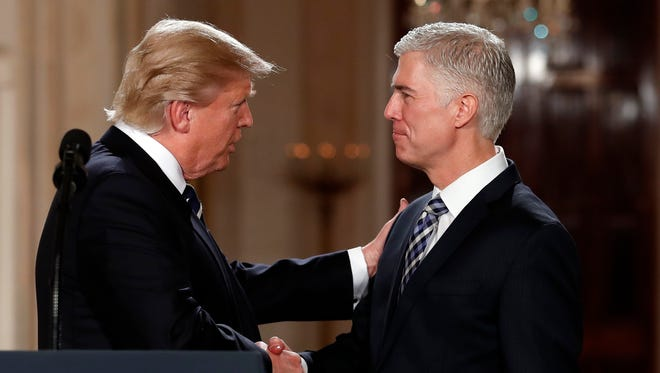 President Donald Trump shakes hands with 10th U.S. Circuit Court of Appeals Judge Neil Gorsuch, his choice for Supreme Court justice.