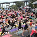 Visitors to Centennial Park in Fort Myers participate in Yoga on the Steps on Sunday which is an event organized by Living Beyond Breast Cancer designed to raise funds and support members of the local community who are battling breast cancer.