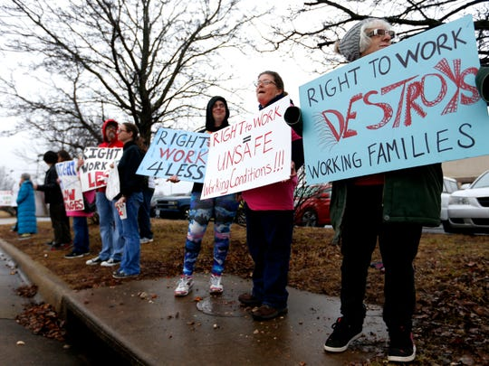 "Protesters line the street outside the abandoned Amelex warehouse in Springfield, Mo. where then-Missouri Gov. Eric Greitens held a ceremonial signing of ""right-to-work"" legislation on Monday, Feb. 6, 2017."