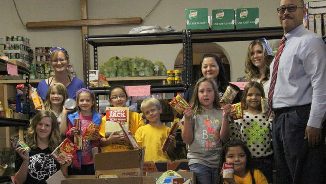La Luz Elementary School students donated 1,871 can and non-perishable goods to the Our Lady of the Light Catholic Church Food Pantry Nov. 13. The kindergarten through second-grade and the third- through fifth-grade students competed against each other to see who could collect the most goods to donate to the pantry. Katie Satathite's third-grade class won a pizza party for collecting the most donated goods in the third- through fifth-grade while Ashley McClinton's first-grade class won in the kindergarten through second-grade class.