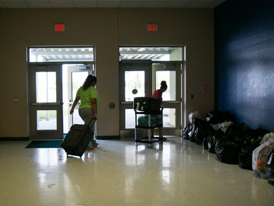 People who stayed at Oak Hammock Middle School leave