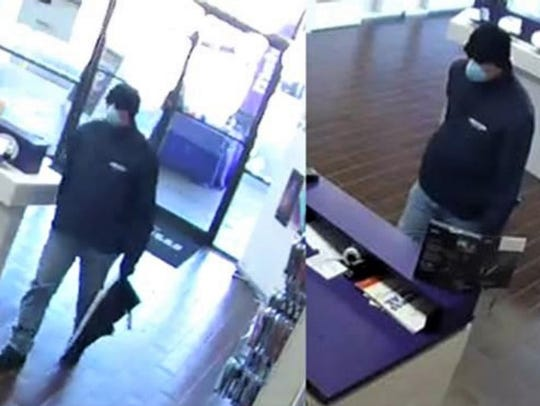 Security camera images of cellphone store robber on