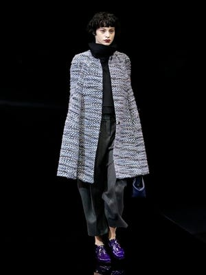 A model wears a creation for Emporio Armani women's Fall-Winter 2015-2016 collection, part of Milan Fashion Week, unveiled in Milan, Italy, Friday.