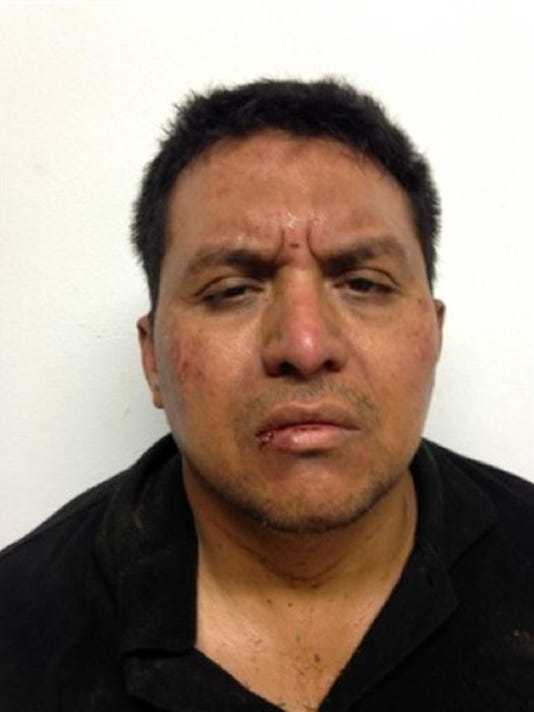FILE - This file photo shows a mug shot, released on July 15, 2013 by Mexico's Interior Ministry, of Zetas drug cartel leader Miguel Angel Trevino Morales after his arrest in Mexico.