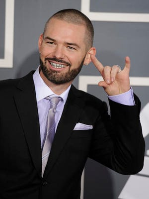 FILE - In this Sunday, Feb. 13, 2011, file photo, Paul Wall arrives at the 53rd annual Grammy Awards in Los Angeles. Court documents show Paul Michael Slayton, known as Paul Wall, was arrested Friday, Dec. 23, 2016, in Houston along with fellow rapper Ronald Bryant, known as Baby Bash and face felony drug-related charges.