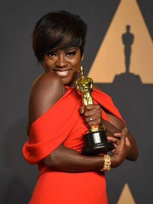 FILE - In this Feb. 26, 2017 file photo, Viola Davis poses in the press room at the Oscars at the Dolby Theatre in Los Angeles. Davis will be presented with the Harvard Foundation 2017 Artist of the Year Award. The actress will accept her arts medal at a ceremony Saturday, March 4, 2017, at Harvard's Cultural Rhythms Festival in Cambridge, Mass.