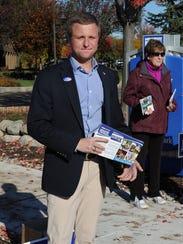 Novi City Council candidate Sam Olsen, campaigning